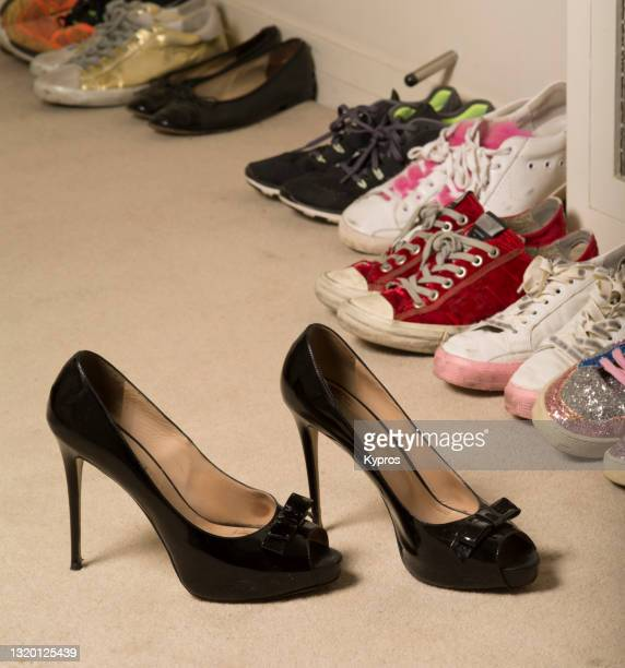 high heels and running shoes - london - womenswear stock pictures, royalty-free photos & images