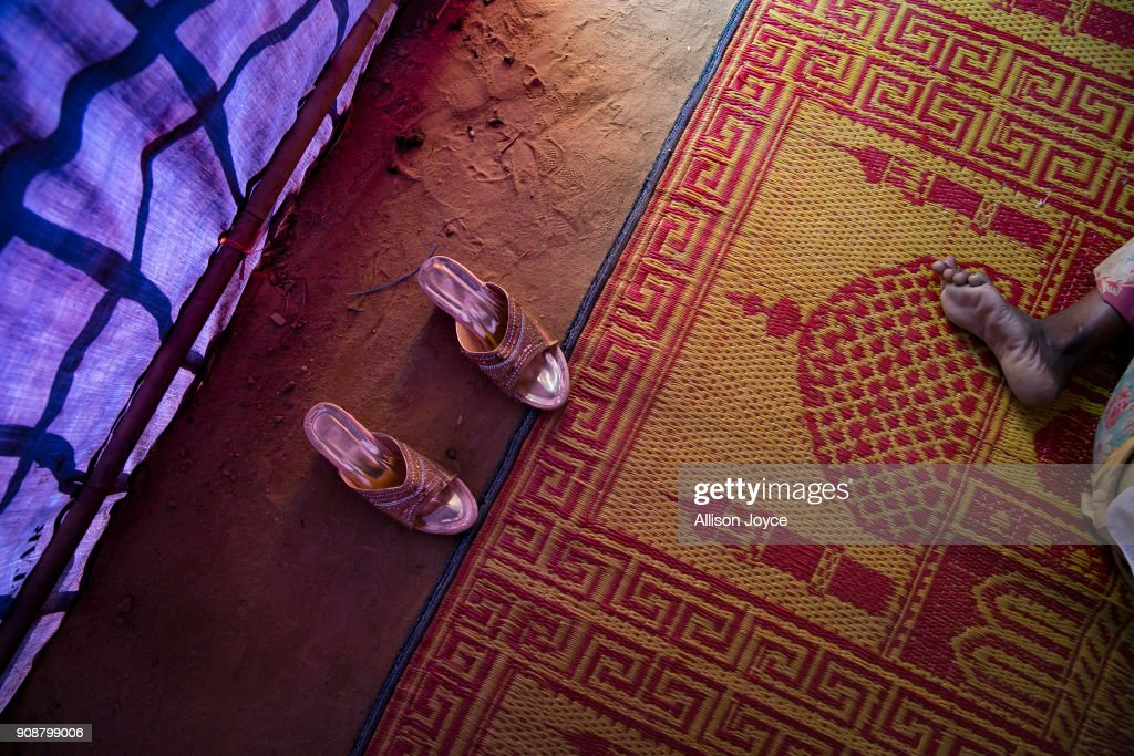 COX'S BAZAR, BANGLADESH - JANUARY 19: High heels are seen as prayer takes place on January 19, 2018 in Cox's Bazar, Bangladesh. In the refugee settlement of Balukhali, over 116 widows and orphans have found shelter within a dense settlement of 50 red tents where no men or boys over the age of 10 years old are allowed. More than 655,000 Muslim Rohingya have crossed the border into Bangladesh since August last year, when they fled Rakhine state after the Myanmar military launched a brutal crackdown which was described by the United Nations as 'ethnic cleansing'. Women and girls reportedly make about 51 percent of the distressed and traumatized Rohingya population in the refugee camps and face a high risk of being victims of human trafficking and sexual abuse, while adolescent girls aged between 13 and 20 risk getting involved in forced marriages. Many of the Rohingya women travelled alone after their husbands had been killed or taken away during the attacks on Rohingya villages as many continue to fear returning home due to the lack of security guarantees.