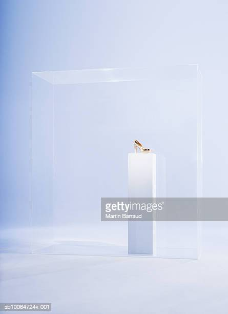 High heels on pedestal in glass cabinet