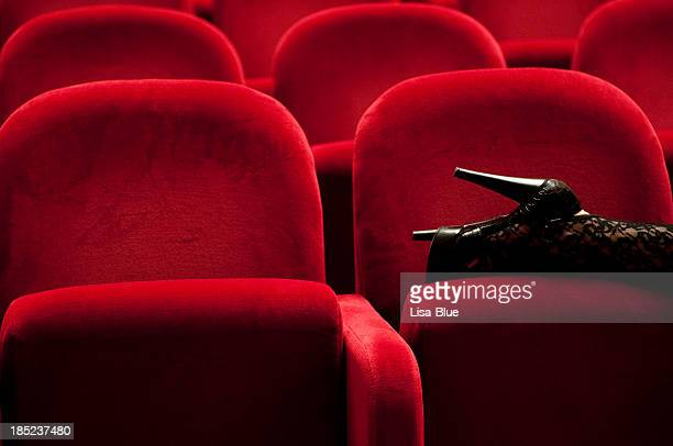 high heels on theater chair. - foot fetishes stock pictures, royalty-free photos & images