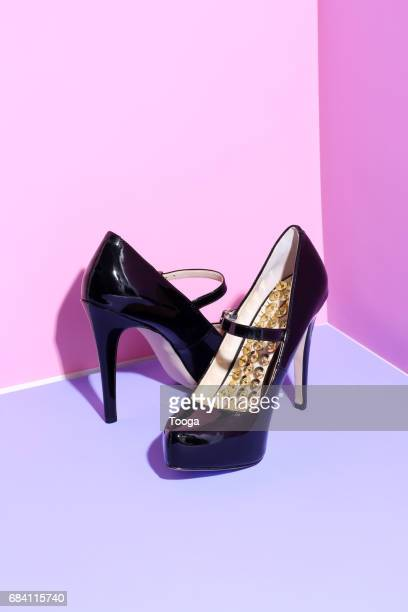 high heels with thumbs tacks - high heels stock pictures, royalty-free photos & images
