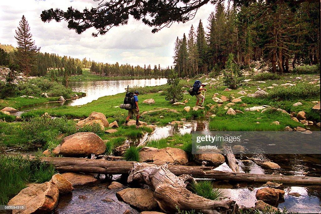 High in the John Muir Wilderness, backpackers Eric and Jeff Winter enter Sallie Keyes Lakes, elevati : News Photo
