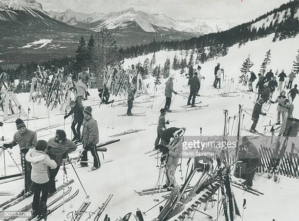 High in the Rockles in the Lake Louise area a group of skiers prepare for an exhilarating day on the trails There are 34 of them serviced by eight...