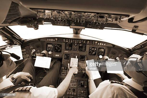 high in the sky with young pilots - co pilot stock photos and pictures