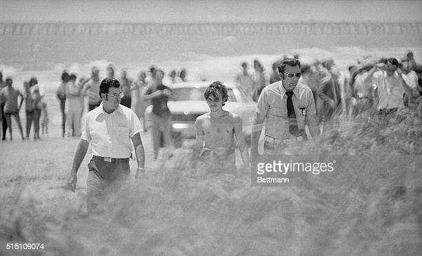 High Island, Texas: Elmer Wayne Henley leads law enforcement agents along a grassy dune on a beach at High Island, Texas, August 10, as they search...