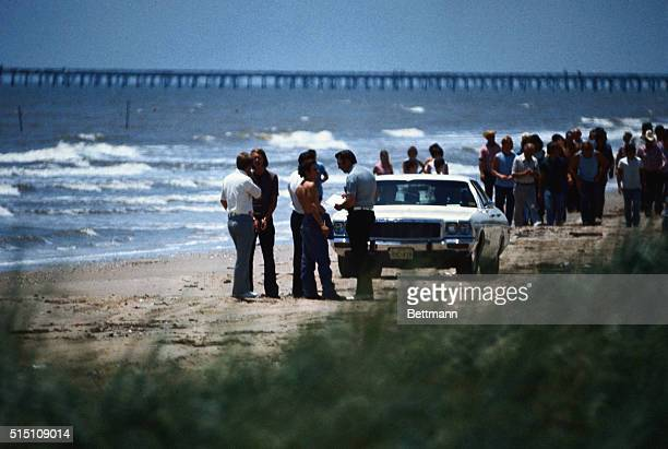 High Island, TX.: David O. Brooks, murderer in background wearing handcuffs as Elmer Henley lead law enforcement agents, as they search for more...