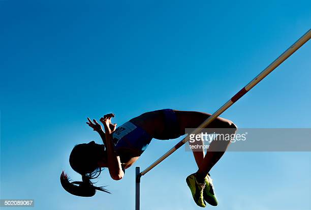 high jump silhouette against the blue sky - high jump stock pictures, royalty-free photos & images