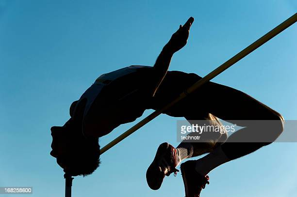 high jump silhouette - high jump stock pictures, royalty-free photos & images