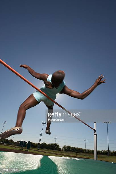 high jumper clearing bar - forward athlete stock pictures, royalty-free photos & images