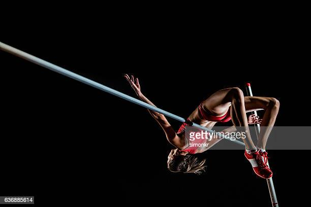 high jumper performing - athletics stock photos and pictures