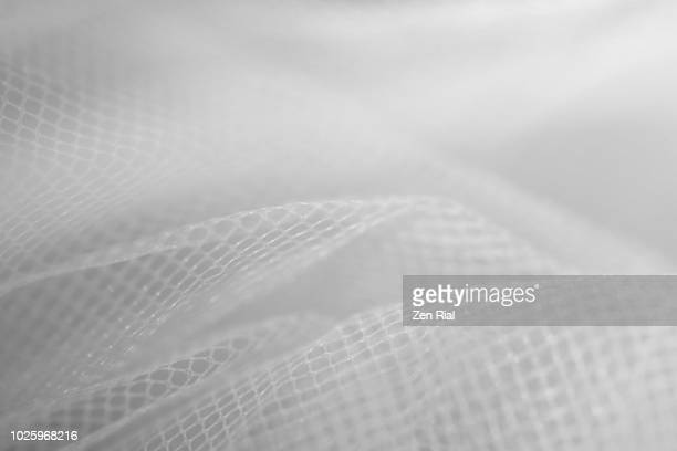 High key image of white tulle netting fabric