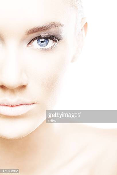 High key portrait of beauty with blue eyes