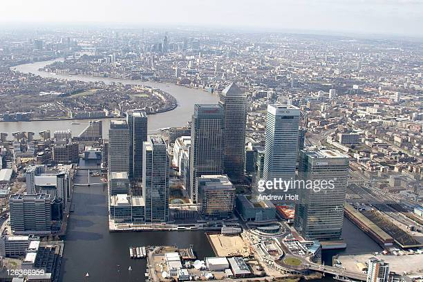 A high level and oblique aerial view of the Canary Wharf commercial and financial district and the surrounding Isle of Docks.