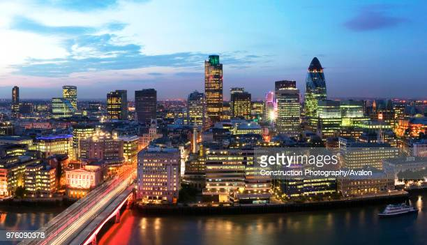High Level view of City of London skyscraper cluster at Night with dramatic sky