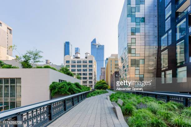 high line park and skyscrapers of hudson yards, new york city, usa - chelsea new york stock pictures, royalty-free photos & images