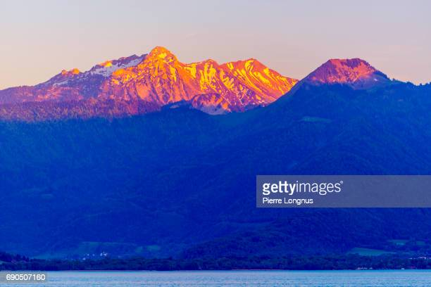 High Mountain Peaks on the Alps and Annecy Lake at Sunset
