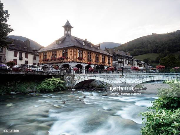 High mountain river that crosses an ancient village in france  Pyrenees, (Arreau)