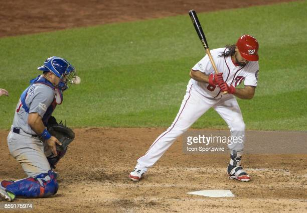 High pitch hits the mask of Chicago Cubs catcher Willson Contreras during game two of the NLDS between the Chicago Cubs and the Washington Nationals...
