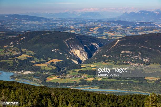 high point of view french hilly landscape on ain and jura departments from grand colombier mountain, with the end of day sunlight in summer in european alps - rhone stock pictures, royalty-free photos & images