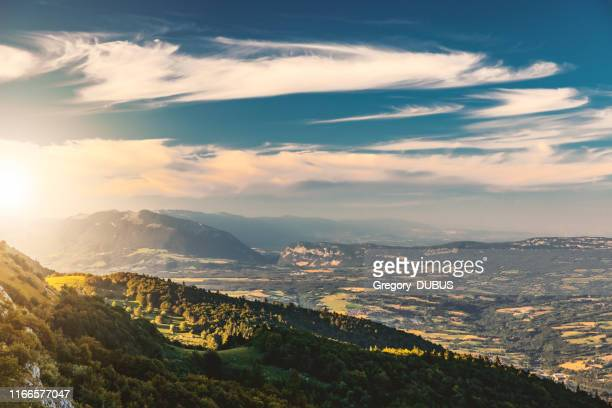 high point of view french hilly landscape on ain and jura departments from grand colombier mountain, with the end of day sunlight in summer in european alps - auvergne rhône alpes stock pictures, royalty-free photos & images