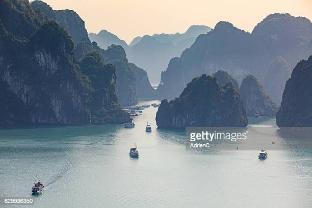 high point of view on old boats cruising around through Halong Bay