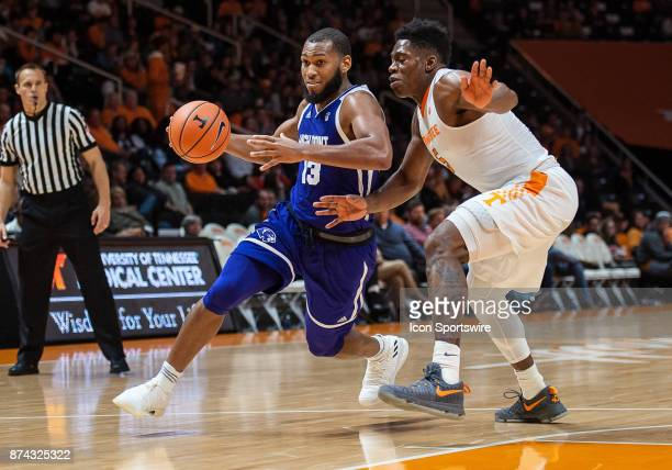 High Point Panthers guard Jahaad Proctor drives around Tennessee Volunteers forward Admiral Schofield during a game between the High Point Panthers...