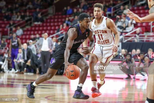 High Point Panthers guard JohnMichael Wright drives the ball past Boston College Eagles guard Derryck Thornton during the game between Boston College...
