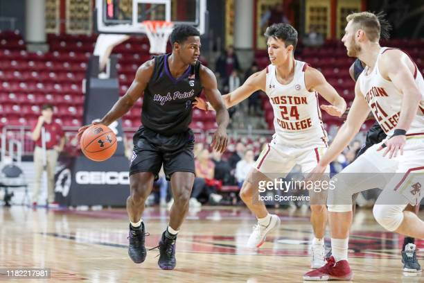 High Point Panthers guard JohnMichael Wright drives the ball past Boston College Eagles guard Chris Herren Jr during the game between Boston College...