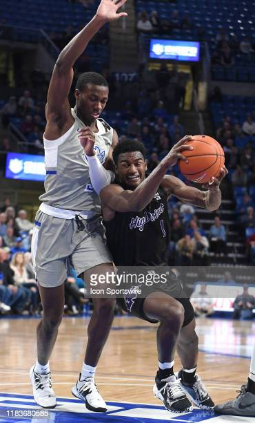 High Point Panthers guard JohnMichael Wright drives under Saint Louis guard Javonte Perkins during a nonconference college basketball game between...