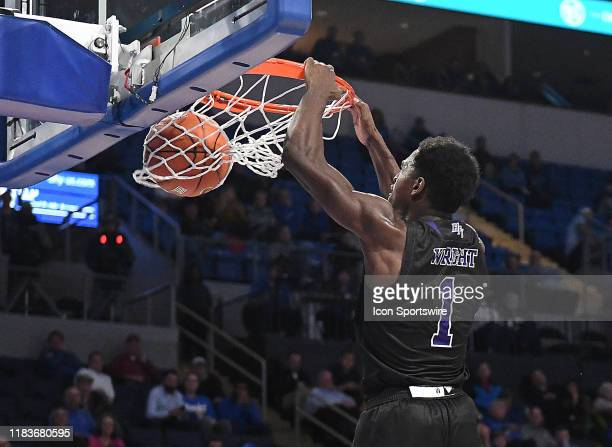High Point Panthers guard JohnMichael Wright dunks a shot in the second half during a nonconference college basketball game between the High Point...