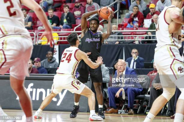 High Point Panthers guard JohnMichael Wright looks for an open teammate to pass the ball to during the game between Boston College Eagles and the...