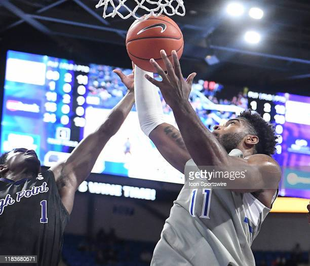 High Point Panthers guard JohnMichael Wright tries to block a shot by Saint Louis forward Hasahn French during a nonconference college basketball...