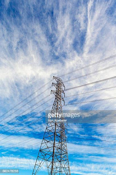 high power electric tower and power lines. - koeberer stock pictures, royalty-free photos & images