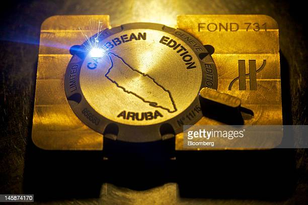 A high prescision laser is seen engraving a watch case at the headquarters of Hublot SA in Nyon Switzerland on Tuesday June 5 2012 Hublot SA Chairman...