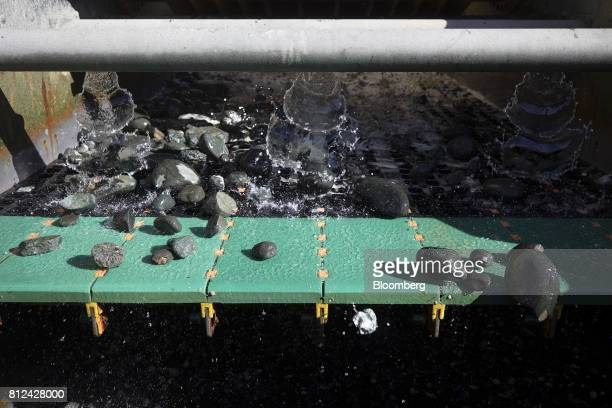 A high pressure spray cleans discarded rock from the seabed following processing before returning to the sea aboard the Mafuta diamond mining vessel...