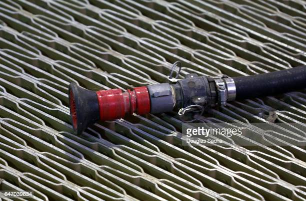 High pressure water hose and nozzle used in fire fighting