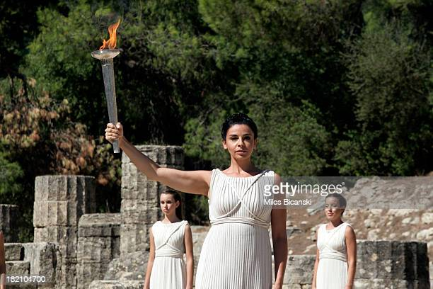 High Priest Ino Menegaki holds the Olympic Flame during the final dress rehersal of the Flame Lighting Ceremony for the 2014 Sochi Winter Olympic...