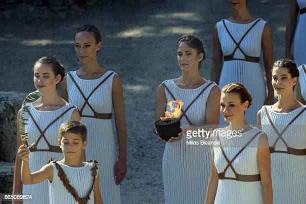 High priestess holds a pot with the Olympic flame as they perform at the Ancient Stadium during the dress rehearsal for the lighting ceremony of the...