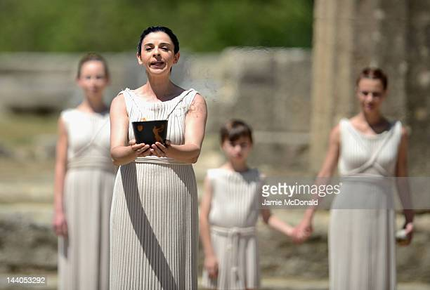 High Priestess Ino Menegaki lifts the Archaic Pot at the Ancient Stadium during the Rehearsal for the Lighting Ceremony of the Olympic Flame at...