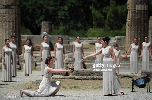 High Priestess Ino Menegaki lights the Archaic Pot at the Ancient Stadium during the Rehearsal for the Lighting Ceremony of the Olympic Flame at...