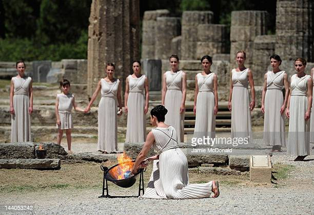 High Priestess Ino Menegaki lights the Olympic flame at the Ancient Stadium during the Rehearsal for the Lighting Ceremony of the Olympic Flame at...