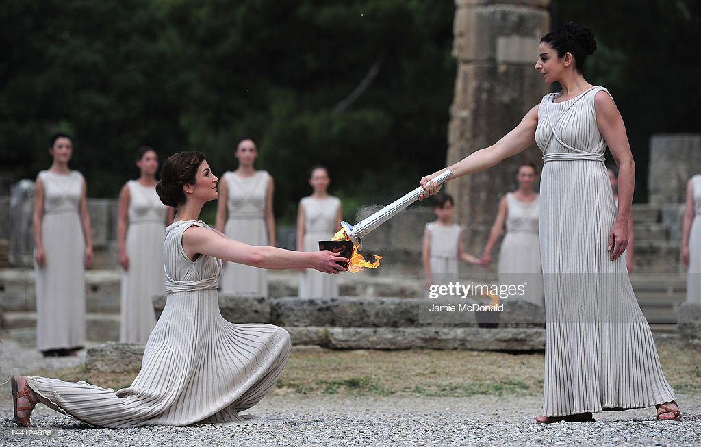 High Priestess Ino Menegaki lights the Olympic flame at the Temple of Hera during the Lighting Ceremony of the Olympic Flame at Ancient Olympia on May 10, 2012 in Olympia, Greece.