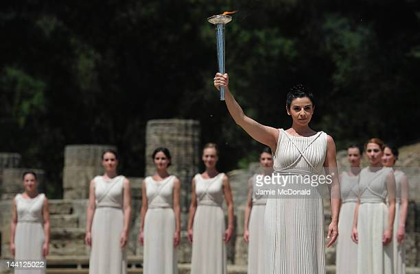 High Priestess Ino Menegaki lights the Olympic flame at the Temple of Hera during the Lighting Ceremony of the Olympic Flame at Ancient Olympia on...