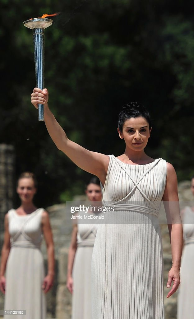 High Priestess Ino Menegaki lights the Olympic flame at the Temple of Hera during the Lighting  sc 1 st  Getty Images & Lighting Ceremony Of The Olympic Flame Photos and Images | Getty ... azcodes.com