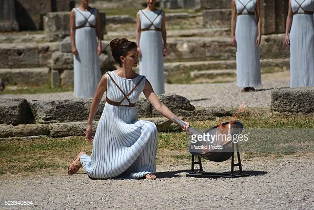 High Priestess Katerina Lehou is lighting the torch of the Olympic Flame in the temple of Hera in Ancient Olympia