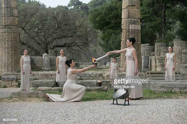 High Priestess Maria Nafpliotou lights the torch from the Archaic Pot in the Sacred Alti during the Lighting Ceremony of the Olympic Flame at Ancient...