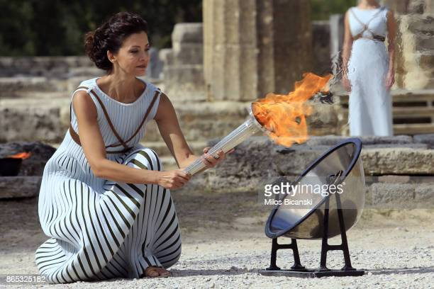 High priestess passes the Olympic flame at the Temple of Hera during a dressed rehearsal of the lighting ceremony of the Olympic flame in ancient...
