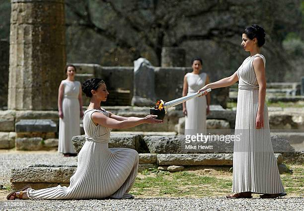 High Priestess Thalia Prokopiou lights the Olympic flame during the Lighting of the Olympic Flame ceremony for the Athens 2004 Olympic Games at the...