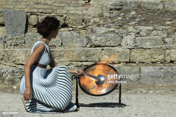 High priestesses lights the Olympic flame at the Temple of Hera as perform at the Ancient Stadium during the dress rehearsal for the lighting...