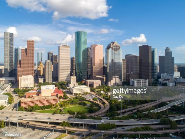 high quality panorama aerial view of downtown houston in texas skyline, with commercial building in a blue sky day. - houston stock pictures, royalty-free photos & images